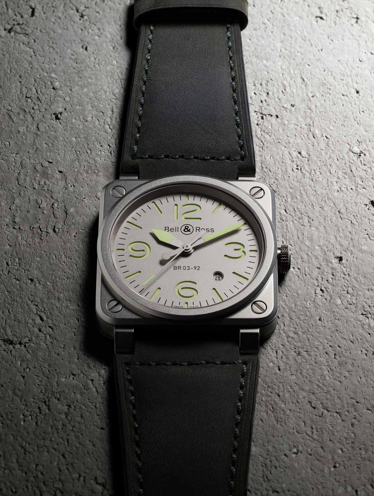 La BR 03-92 Horolum is worn on a grey-green calfskin and ultra-resistant black synthetic fabric strap.