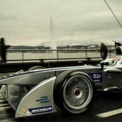 The Formula E car driving across Geneva's Mont-Blanc bridge