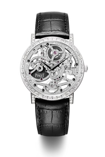 """Piaget_334043_2"""" />As a past master in the ancestral art of skeleton-working, Piaget has developed and created the world's thinnest skeleton models: Caliber 600S and Caliber 1200S, introduced in 2004 and 2012, respectively. But the display of virtuoso brilliance does not stop there, since the Manufacture took things to the next level in 2005 by gem-setting for the first time not only the various decorative parts and additional plates of a skeleton movement, but also the entire gold mainplate and functional parts. Embodying this expertise that is indeed unique in the world, Caliber 600D presented in 2005 was followed in 2010 by Caliber 838D, prefiguring another stellar embodiment of the watchmaking art now unveiled at the SIHH 2013: Caliber 1200D, thefirst ever automatic gem-set skeleton movement.Successor to the already iconic automatic skeleton caliber 1200S with its peerless slenderness, Caliber 1200D is the 34th movement to be entirely developed and produced by the Manufacture in the last 15 years. It is an unprecedented feat blending watchmaking and jewelry know-how, and its extensive two-year development process alone called upon the full range of Piaget's skills. Mirroring Piaget's unique mastery, this 3 mm movement representing the thinnest in the world in its category is adorned with 259 brilliant-cut diamonds (approx. 0.8 ct) and 11 black sapphire cabochons (approx. 0.2 ct) set within a diameter of 31.9 mm. This exceptional gem- setting requires four days of work to complete just one movement.<strong><em>Delicate craftsmanship mastered by only a few jewelry artisans</em></strong>Setting the entire mainplate also requires paving the functional parts – a constant challenge mastered by only a rare few jewelers. An ultra-thin caliber naturally comprises extremely slender parts, such as the jumper-spring cover that measures just 0.69 mm. The Piaget master- jewelers even applied their artistry to concealing the screw threads beneath black sapphire cabochons.Refle"""
